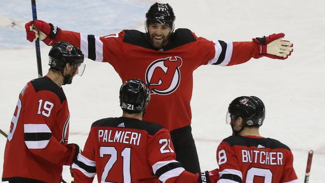 The Devils celebrate a first-period goal scored by Kyle Palmieri (21) during Game 4 of the first round of the Stanley Cup Playoffs  against the Tampa Bay Lightning on Wednesday, April 18, 2018 at Prudential Center, Newark.