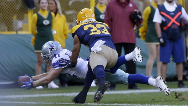 PACKERS17 PACKERS  - Dallas Cowboys wide receiver Cole Beasley (11) scores a touchdown past Green Bay Packers strong safety Micah Hyde (33) during the 1st quarter of the Green Bay Packers game against the Dallas Cowboys at Lambeau Field in Green Bay, Wis. on Sunday, October 16, 2016. Mike De Sisti / MDESISTI@JOURNALSENTINEL.COM
