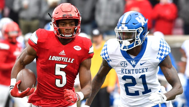 Louisville's Seth Dawkins (5) runs from Kentucky's Chris Westry (21) during the first half of an NCAA college football game, Saturday, Nov. 26, 2016, in Louisville, Ky.