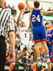 Central York's Courtney Batts (1) attempts a fade-away