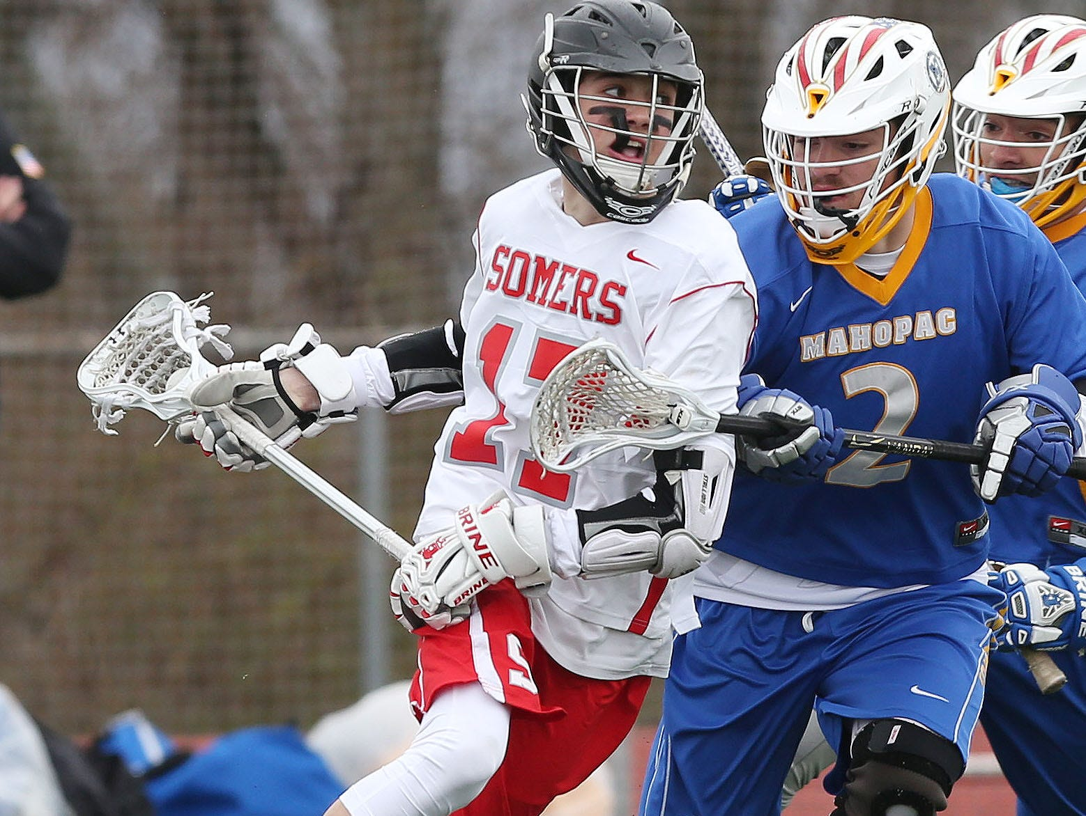 From left, Somers' Graham Roediger (17) works his way around Mahopac's Tom Wilson (2) as he drives to the goal during a boys lacrosse game at Somers High School April 9, 2016. Somers won the game 8-7.