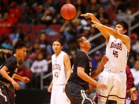 Chinle Angelo Lewis (35) guards Winslow Zach Wagner (45) during the Boys 3A basketball semi-finals game at Gila River Arena in Glendale on February 23, 2018.