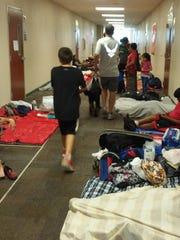 Evacuees lined the halls of Oak Hammock Middle School