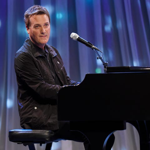 Michael W. Smith performs during the telethon for...