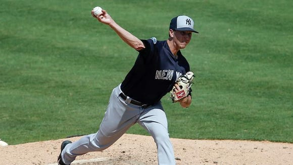 New York Yankees pitcher Conor Mullee pitches during
