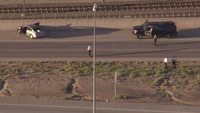 Helicopter photos show the scene of a homicide in Denver where police say an Uber driver shot a passenger.