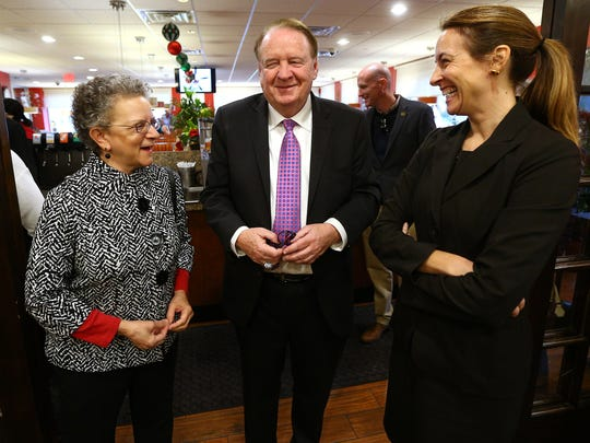 Assemblywoman Mila Jasey, l, and former governor Richard Codey talk with Mikie Sherrill,  joining dozens of Democrats to endorse the Democratic congressional candidate at the Florham Park Diner to oppose the 11th districts Rep. Rodney Frelinghuysen in 2018. December 5, 2017. Florham Park, New Jersey