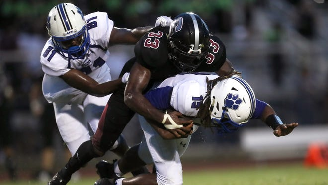 Chiles's Amari Gainer sacks the quarterback, Godby's Rasean McKay during their game at Chiles High School on Friday, Aug. 25, 2017.