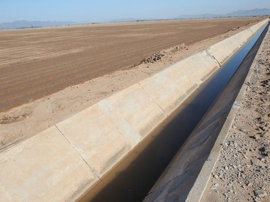 A canal is filled with runoff after a rainstorm next to a field near Blythe.