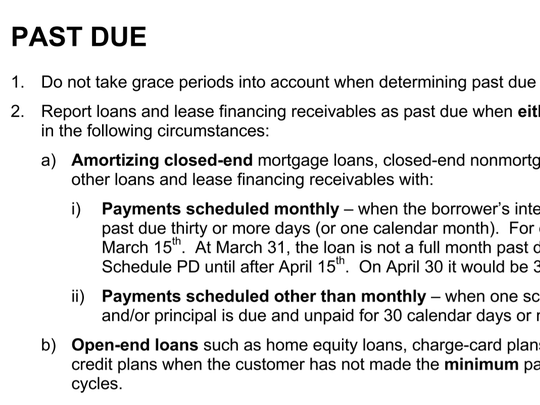 An image of a court exhibit from prosecutors shows rules banks are to follow when disclosing whether their loans are past due.