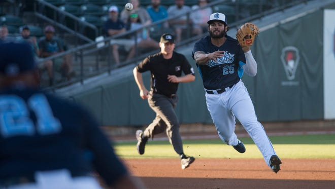 Hooks infielder Bryan Muniz (25) throws to first base in the first inning on May, 06, 2017 at Whataburger Field