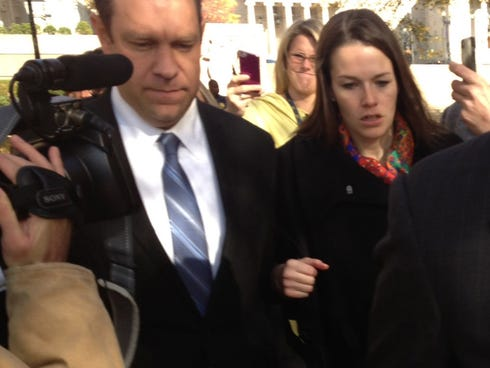 Rep. Trey Radel, R-Fla., left, leaves District of Columbia Superior Court on Nov. 20 in Washington after pleading guilty to possession of cocaine. The woman with him is Lisa Manning, a member of his defense team.