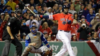 David Ortiz hits a two-run home run in the seventh inning to give the Red Sox a 5-3 lead over the Blue Jays.