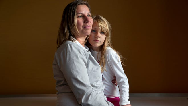 Peggy Young with her daughter, Triniti, 7.