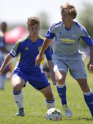 The Bavarian Soccer Club's Brandon Lifke, left, defends against Kansas Rush Academy's Emery May during their U18 semifinal soccer game in the US Youth Soccer 2015 Region II Championships Tuesday at the Scheels USA Youth Sports Complex in Appleton. The Bavarians lost 4-2 in overtime.