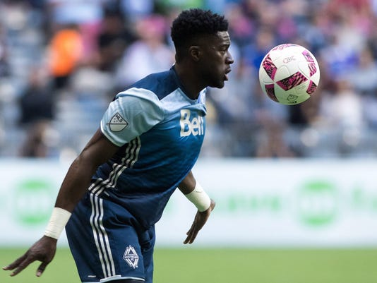 Vancouver Whitecaps' Alphonso Davies plays the ball against the Seattle Sounders during the first half of an MLS soccer game in Vancouver, British Columbia, Sunday Oct. 2, 2016. (Ben Nelms/The Canadian Press via AP)