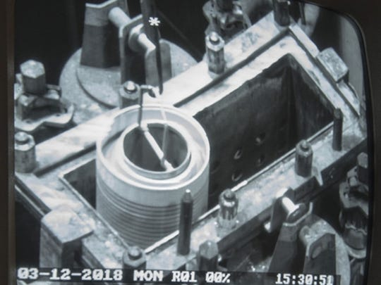 A High Flux Isotope Reactor core is dropped into Savannah River Site's H Canyon dissolver.