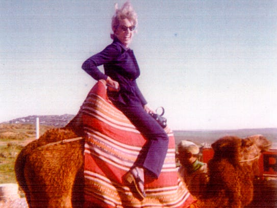 Betty Bright on a camel in North Africa in the early
