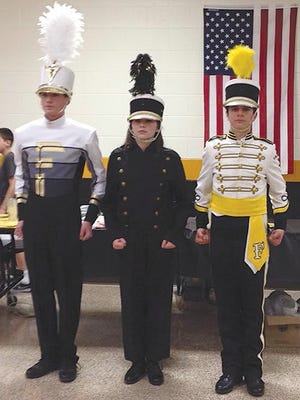 Fairview High School band members model uniforms to reveal how they have changed over the years. The Dress the Band campaign currently underway will allow for the purchase of new uniforms (left).