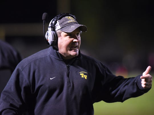 Coach Justin Buttermore encourages his team during Tri-Valley's 27-18 win against Columbus Marion-Franklin on Friiday night in a Division III, Region 11 quarterfinal game.