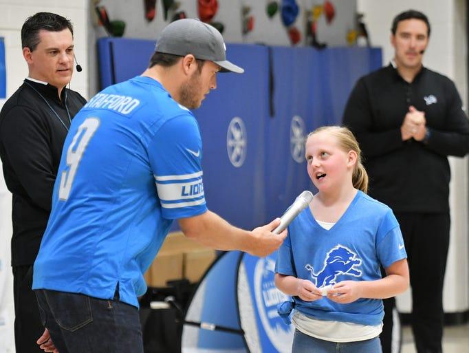 Maddie Lauer, 10, asks Lions quarterback Matthew Stafford