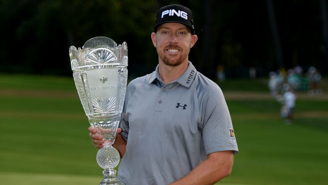 Hunter Mahan celebrates with the trophy after winning The Barclays on Sunday. He finished at 14-under 270 and moved to No. 1 in the FedEx Cup standings.