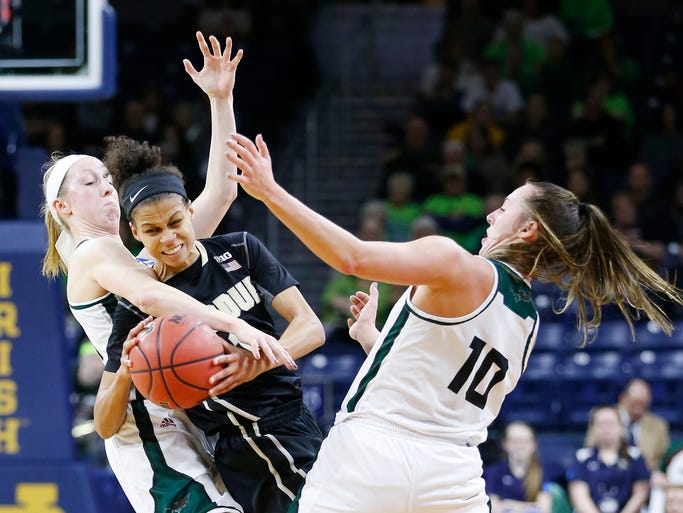 Ashley Morrissette is fouled by Allie Leclaire, left,