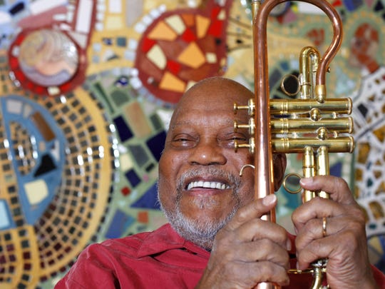 Legendary Jazz trumpet player Marcus Belgrave, 76 of Detroit, shares a smile while in front of the 'Detroit's Music' bricolage before his rehearsal at the Virgil H. Carr Cultural Arts Center in Detroit on Tuesday, Aug. 21, 2012.