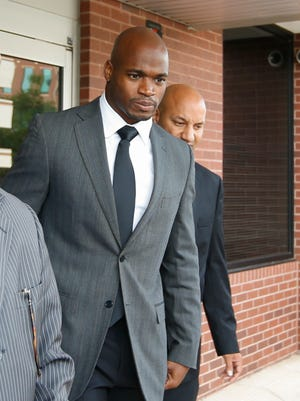 Vikings running back Adrian Peterson leaves the Montgomery county courthouse in October.