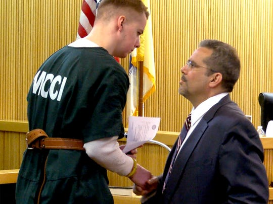 Liam McAtasney shakes hands with his attorney Carlos Diaz-Cobo after a hearing before Judge Richard W. English at State Superior Court in Freehold Monday, March 26, 2018.  The judge had earlier released his decision on the admissibility of the videotaped confession made be McAtasney.