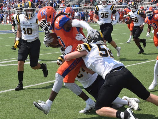 Southwestern University of Texas defenders Elijah Smith (24, back, right) and David-Alvin Quinton (52, front right)wrap up Louisiana College's Leonard James (17, far right) NCAA Division III game against Southwestern University of Texas held Saturday, Sept. 23, 2017 at Louisiana College in Pineville, La.