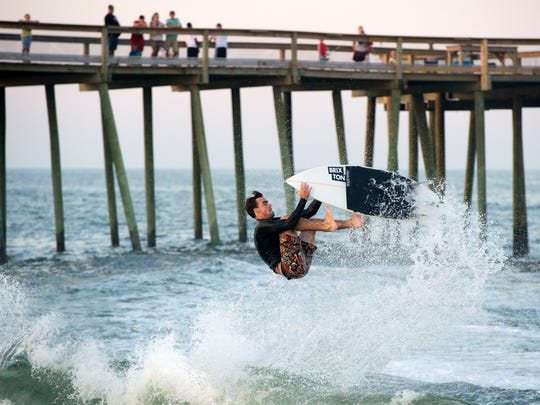 Seth Conboy, representing Atlantic Shoals Surf Shop, competes in the Surf Shop Showdown during Dew Tour in Ocean City. Eight local amateurs participated in the tow-at event, sponsored by Sanuk.