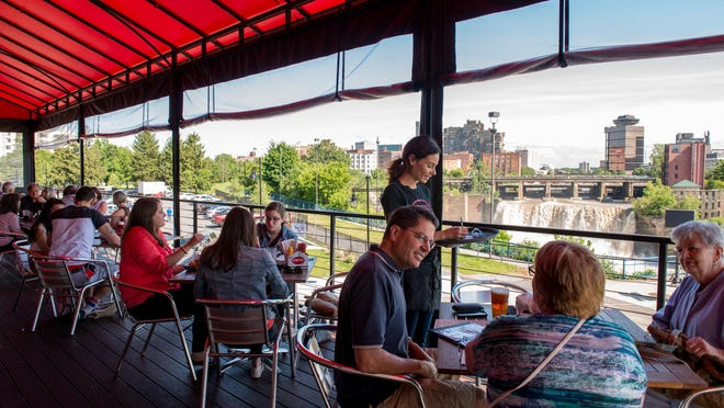 Genesee Brew House has an outdoor dining terrace with a view of High Falls.