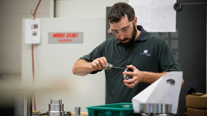CNC Machinist Matt Meritt of Greece assembles parts at the Morgood Tools facility in Chili. Morgood Tools started in 1945 when three business partners merged shops. Its does special grinding and custom tooling for other companies that make special parts.