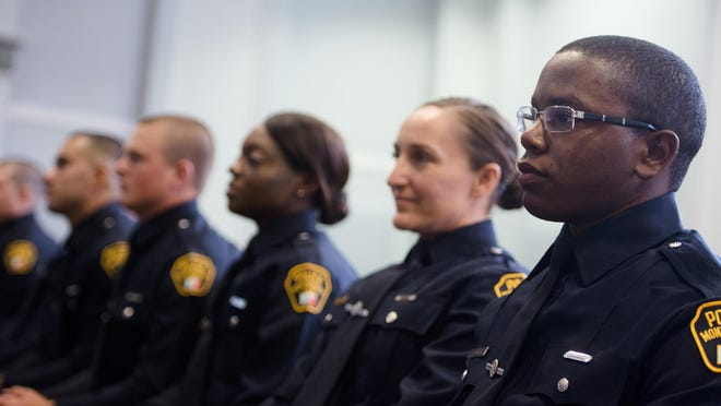 Officer Ja'Marcus Markel Young looks on during the Montgomery Police Academy Graduation on Thursday, July 9, 2015, in Montgomery, Ala. Thirteen new officers took their oath of office.