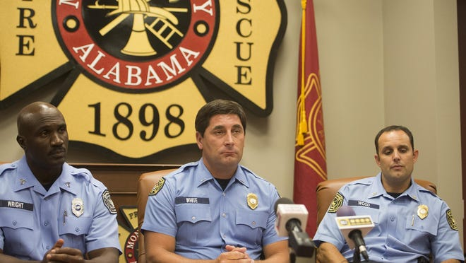 From left, Montgomery Fire Investigators Sgt. L.D. Wright, Lt. S. White Capt. R.C. Wood speaks during a press conference on Thursday, July 9, 2015, at Montgomery Fire Headquarters announcing three arrests in the South Lawn Elementary fire. Montgomery firefighters responded to a fire at South Lawn Elementary on June 27, 2015.
