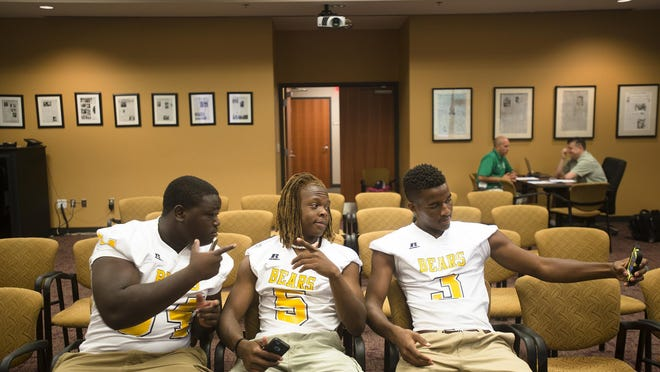 From right, Isaac Green takes a selfie with Derrick Dunigan and Darius Reese on Thursday, July 30, 2015, at the Montgomery Advertiser in Montgomery, Ala.