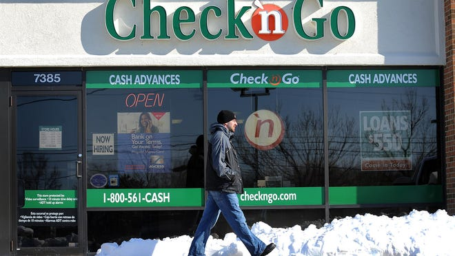 The Check-N-Go payday loan store at 7385 N Shadeland Ave is seeing more business from high-income customers during this recession. (Matt Kryger / The Indianapolis Star) <b>02/03/2009 - A01 - MAIN - 2ND - THE INDIANAPOLIS STAR</b><br />Need cash: Payday loan outlets, such as this one near 75th and Shadeland, are seeing higher-income customers. Americans pay as much as $8 billion a year to borrow $50 billion from payday lenders.