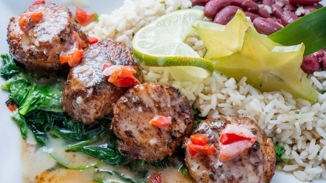 Havana Cabana's Coquille St.-Jacques jumbo diver scallops are served with rice and beans.