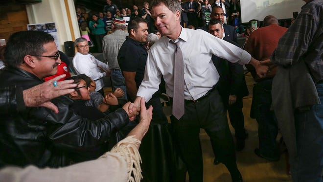 Mayor Joe Hogsett greets members of the crowd after speaking at a rally organized by the Indianapolis Congregation Action Network at St. Philip Neri Catholic Church, Indianapolis, Sunday, Feb. 12, 2017. The meeting addressed concerns raised by Jewish, Muslim and Christian faith leaders about President Donald Trump's executive order, which they believe unfairly targets immigrants, refugees and Muslims.