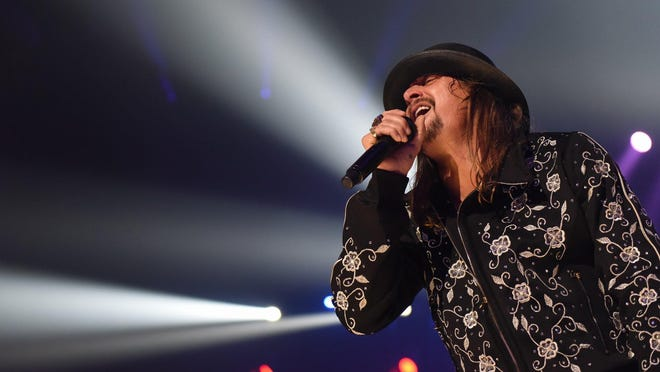 Kid Rock performs at Little Caesars Arena in Detroit on Tuesday night, Sept. 12, 2017. His appearance was met by dozens of protesters from a civil rights group. (Tanya Moutzalias/The Ann Arbor News-MLive.com Detroit via AP)