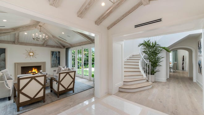 At 225 Arabian Road, the foyer acts as an organizing point in the house, leading to the living room at the left and the stair hall to the right. The house is for sale at $6.695 million.