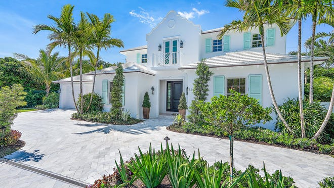 A new house with Bermuda-influenced architecture has sold for a recorded $6.56 million at 154 Atlantic Ave. in Palm Beach. The four-bedroom house's asking price was $7.5 million.
