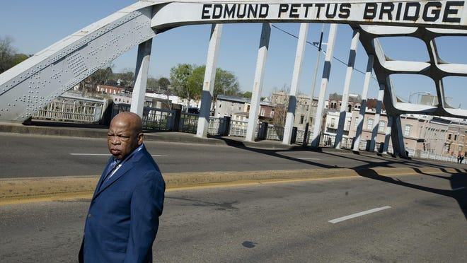 """Congressman John Lewis stands on the Edmund Pettus Bridge on Sunday in Selma during the annual commemoration of """"Bloody Sunday,"""" the day in 1965 when voting rights protesters were attacked by police as they attempted to cross the Edmund Pettus Bridge."""