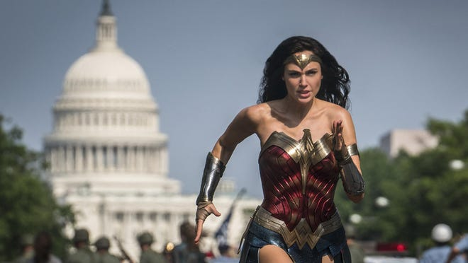 "Gal Gadot stars as Wonder Woman in ""Wonder Woman 1984."" Warner Bros. will hold a 24-hour virtual event in August featuring the biggest heroes in the DC Comics universe."