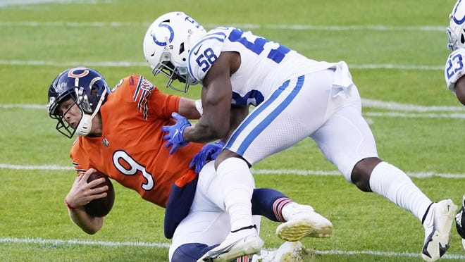 Chicago Bears quarterback Nick Foles (9) is tackled by Indianapolis Colts' Bobby Okereke (58) during the first half of an NFL football game on Sunday in Chicago.