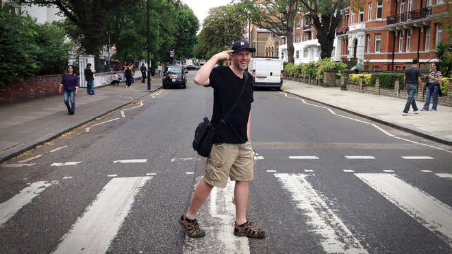 Mike Allore of Oakland Township, multimedia teacher at the Utica Center for Science and Industry, sports the Old English D at the Abbey Road crossing in London in July.