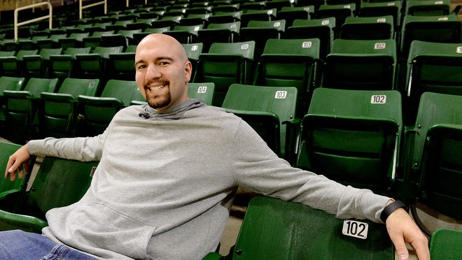 Former MSU and Okemos basketball player Anthony Ianni sits in the seats at the Breslin Center on the campus of Michigan State University. Ianni is using his struggles with autism to advocate for autism awareness and speaks to elementary and high school students on bullying.
