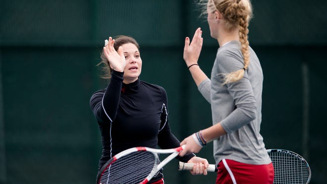 Alabama's Maya Jansen high-fives her partner Erin Routliffe after scoring a point during their doubles win against DePaul at the Blue Gray National Tennis Classic at Lagoon Park on Saturday.