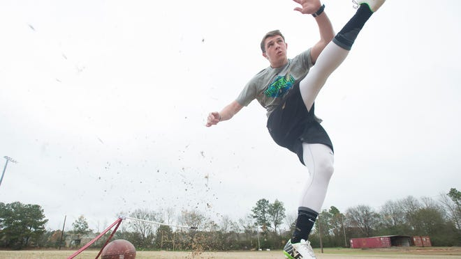 A.J. Reed practices kicking field goals on Friday, March 13, 2015, in Prattville, Ala.